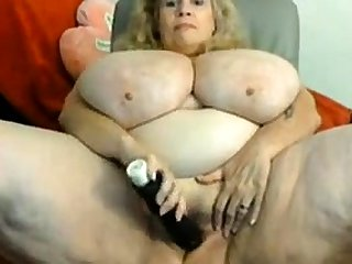 Nasty fat amateur granny toys pussy