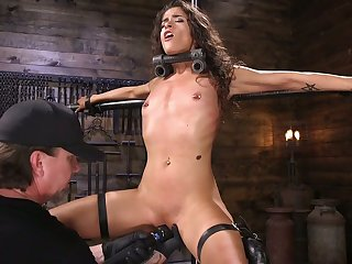 Tied up and suspended chick Victoria Voxxx gets punished by one kinky dude