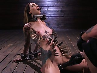 Sextarctive tattooed tart Rocky Emerson is tied all round and toyed by two kinky swear at