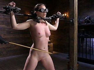 Restrained porn model Casey Calvert is fucked hard in the dark BDSM room