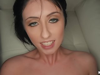 Dark-haired chick lies down to get enclosing holes satisfied