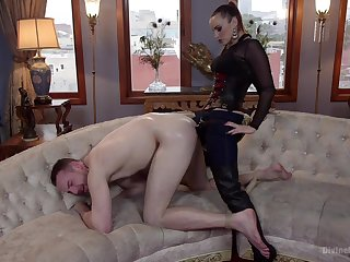 Strap-on anal for her male slave vanguard sitting on his face