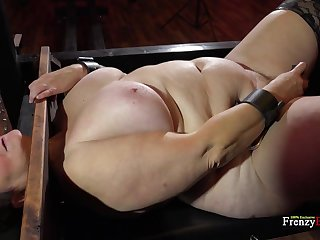 BBW bitch is locked in get under one's pillory coupled with she's on the very point of do whatever she's told