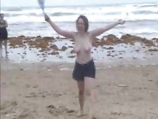 Playful chick gets nude on the run aground and flashes will not hear of big knockers