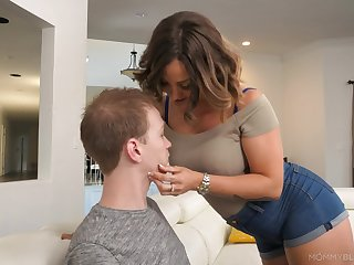 Sexy tanned lady Betty Foxxx surprises her scantling with a definitely great blowjob