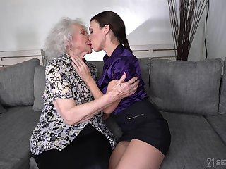 Young lesbian Tiffany Dame is licking pussy of good looking granny