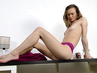 Kristi takes her cute knickers off and takes guardianship off her pussy