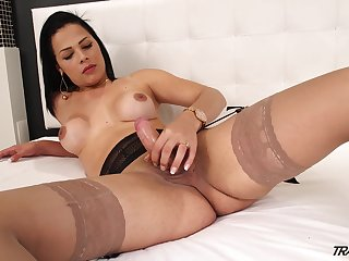Seductive transgender Bruna Castro is playing solo here his dick