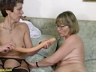 Two horny german mature in sexy stockings sharing a massive dildo