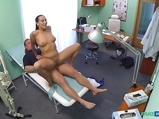 Hot brunette nurse gives patient some sexual healing
